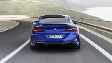 BMW M8 Competition coupe - rear view driving