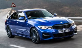 Blue BMW 3 Series driving