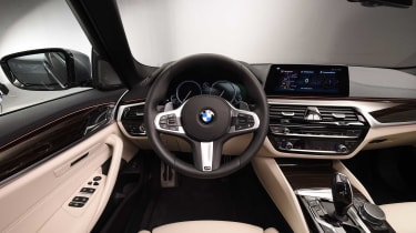 The BMW 5 Series' dashboard is a masterclass in high-quality executive luxury