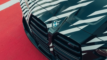 New BMW M4 camouflaged grille