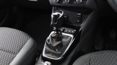 Another gripe: the gearlever is too large to be comfortable, and comes topped in clear plastic, which smears easily