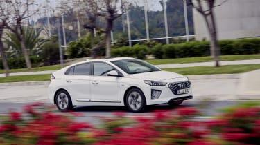 Hyundai Ioniq Plug-in Hybrid driving past flowers