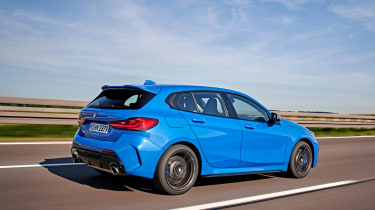 BMW M135i driving - side/rear view