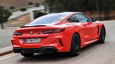 BMW M8 Competition coupe rear 3/4 tracking