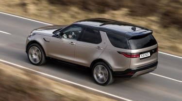Land Rover Discovery SUV rear 3/4 driving