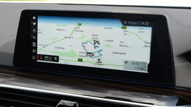 The latest iDrive system now features a touchscreen display, as well as the traditional rotary controller
