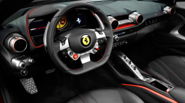 The interior features the familiar Ferrari controls and myriad screens in front of the driver