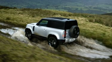 2020 Land Rover Defender 90 - rear 3/4 view off-roading