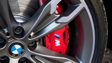 BMW 5 Series saloon red brake callipers