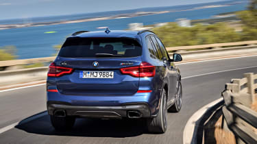 BMW X3 driving - rear