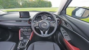 The dashboard has a sporty layout and puts you in the mood for driving fun.