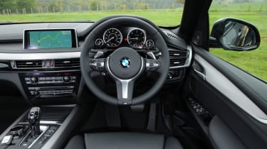 The cabin is dominated by a 10-inch infotainment screen controlled by BMW's iDrive controller