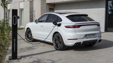 Porsche Cayenne Turbo S E-Hybrid - rear 3/4 charging