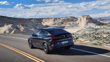 BMW X6 M Competition driving - rear view