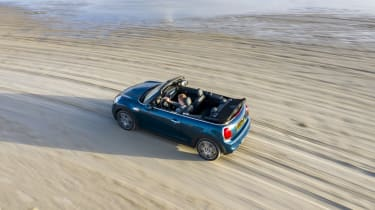 MINI Sidewalk Convertible driving on beach with roof down - top view