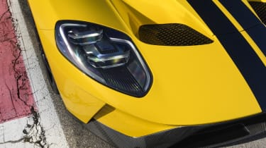 Though the front of the Ford GT recalls its predecessors, this is is purely a mark of respect