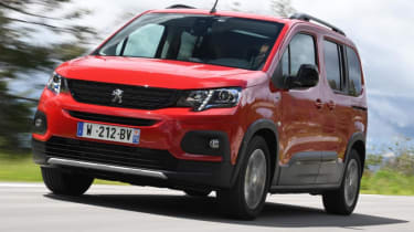 Red Peugeot Rifter driving