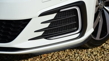 The lower front bumper recalls the GTI