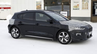 2021 Ford Focus in camouflage - side view