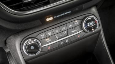 Titanium models and above have dual-zone automatic climate control
