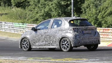 Toyota Yaris driving on circuit in camouflage