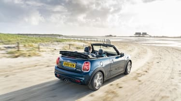 MINI Sidewalk Convertible driving on sand with roof down - Rear view