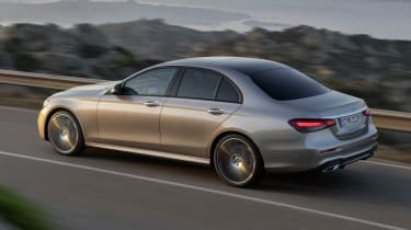 Mercedes E-Class driving with lights on - rear