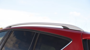 Roof bars hint that the Kuga is about utility, as well as sport