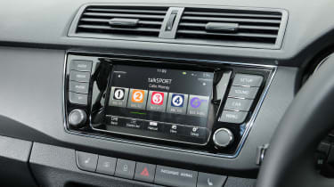 The infotainment system includes Apple CarPlay and Android Auto functionality