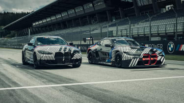 New BMW M4 camouflaged next to DTM version