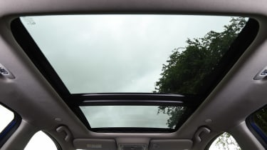 A large panoramic roof fills the interior with light and gives a good view out for rear passengers