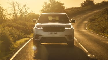 2021 Range Rover Velar P400e plug-in hybrid driving at sunset - front view