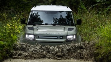 2020 Land Rover Defender 110 P400e plug-in hybrid - front view off-roading