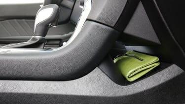 A hidden storage space behind the centre console is useful