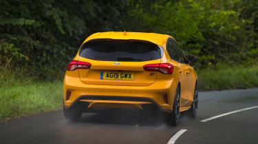 Orange Ford Focus ST driving - rear view