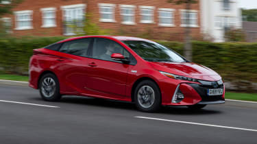 Toyota Prius Plug-in Hybrid hatchback front 3/4 panning