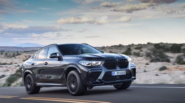 BMW X6 M Competition driving - front side view