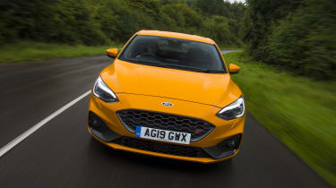Orange Ford Focus ST driving - front view