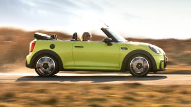2021 MINI Convertible driving along road - side view