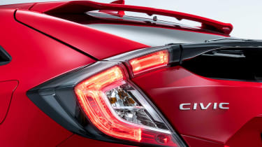 The rear lights of the new Honda Civic have a unique C-shaped light signature