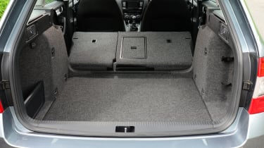 Unfortunately the rear seat doesn't fold to be completely flat