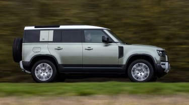 Land Rover Defender 110 - side view passing driving