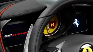 The dashboard screens are configurable, but dominated by a huge yellow dial