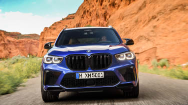 BMW X5 M Competition driving - front end view