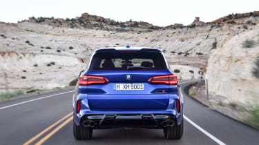 BMW X5 M Competition driving - rear end view