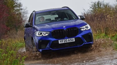 BMW X5 M Competition SUV water splash