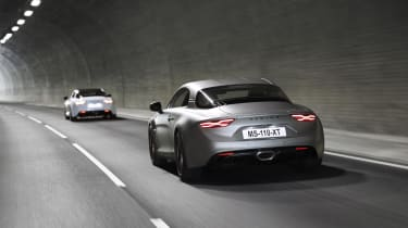 Alpine A110S models driving through tunnel