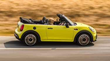 2021 MINI Convertible driving with roof down - side view