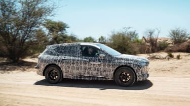 2021 BMW iNEXT electric SUV desert testing - dynamic side view