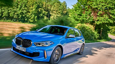 BMW M135i driving in shade - front